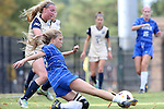 27 October 2013: Duke's Kaitlyn Kerr (in blue) shoots past Pittsburgh's Siobhan McDonough (left). The Duke University Blue Devils hosted the Pittsburgh University Panthers at Koskinen Stadium in Durham, NC in a 2013 NCAA Division I Women's Soccer match. Duke won the game 6-3.