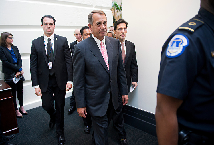 UNITED STATES - OCTOBER 10: Speaker John Boehner, R-Ohio, and House Majority Leader Eric Cantor, R-Va., right, make their way to a news conference after a meeting of the House Republican caucus in the Capitol where they discussed a possible plan to raise the debt ceiling. (Photo By Tom Williams/CQ Roll Call)