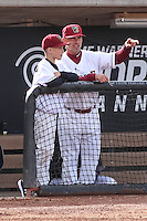 Wisconsin Timber Rattlers manager Matt Erickson (8) with his son, Maddox Erickson, during a Midwest League game against the Beloit Snappers on May 30th, 2015 at Fox Cities Stadium in Appleton, Wisconsin. Wisconsin defeated Beloit 5-3 in the completion of a game originally started on May 29th before being suspended by rain with the score tied 3-3 in the sixth inning. (Brad Krause/Four Seam Images)