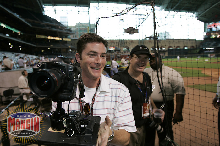 HOUSTON, TX - JULY 8: Photographer Jed Jacobsohn works to set up a floor remote camera during batting practice before the Home Run Derby at the All-Star game at Minute Maid Park on July 8, 2004 in Houston, Texas. (Photo by Brad Mangin)
