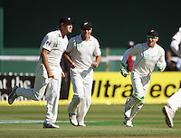 NZ's Tim McIntosh, Ross Taylor and Brendon McCullum celebrate the wicket of VVS Laxman during day one of the 3rd test between the New Zealand Black Caps and India at Allied Prime Basin Reserve, Wellington, New Zealand on Friday, 3 April 2009. Photo: Dave Lintott / lintottphoto.co.nz
