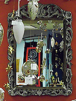 A mirror reflects the bounty in the SERVV Store on Monroe Street in Madison, Wisconsin.