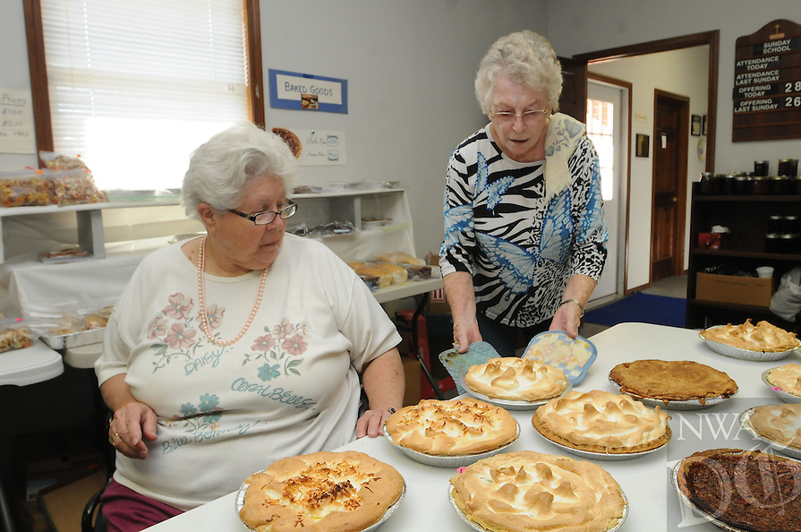 NWA Democrat-Gazette/FLIP PUTTHOFF <br /> FRESH-BAKED PIES<br /> Judy Musselman (left) takes a look at pies Wednesday Oct. 14 2015 brought hot from the oven by Rheta Van Doren (cq) during the Holiday Bazaar at Brightwater Memorial United Methodist Church on U.S. 62 north of Avoca. The bazaar continues today from 7:30 a.m., to 3 p.m. at the church. A lunch of ham and beans or stew is available from 11:30 a.m. to 1 p.m. Items for sale include home-made pies, breads, jellies and other treats, along with crafts and used goods. Money raised benefits the church, Musselman said.
