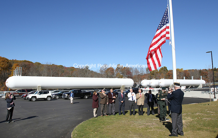 PLYMOUTH CT. 26 October 2015-102615SV08-Town officials and company executives participate in a flag-raising ceremony for the soft opening of Inland Fuels, a propane distribution company that will become the town's second largest taxpayer, in Plymouth Monday.<br /> Steven Valenti Republican-American