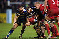 Michael Rhodes of Saracens is tackled by Tom Dunn and Henry Thomas of Bath Rugby. Gallagher Premiership match, between Bath Rugby and Saracens on March 8, 2019 at the Recreation Ground in Bath, England. Photo by: Patrick Khachfe / Onside Images