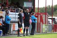 The fourth official indicates a minimum 6 minutes of additional time during Dagenham & Redbridge vs Chesterfield, Vanarama National League Football at the Chigwell Construction Stadium on 15th September 2018