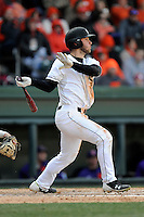 Second baseman Max Schrock (22) of the South Carolina Gamecocks bats in the Reedy River Rivalry game against the Clemson Tigers on Saturday, February 28, 2015, at Fluor Field at the West End in Greenville, South Carolina. South Carolina won, 4-1. (Tom Priddy/Four Seam Images)