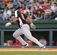 Right fielder Zachary Cone (12) of the Hickory Crawdads in a game against the Greenville Drive on April 9, 2012, at Fluor Field at the West End in Greenville, South Carolina. Cone was a first-round pick by the Texas Rangers in the 2011 First-Year Player Draft. (Tom Priddy/Four Seam Images)