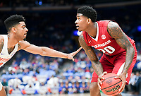NWA Democrat-Gazette/CHARLIE KAIJO Arkansas Razorbacks forward Darious Hall (20) looks to pass during the Southeastern Conference Men's Basketball Tournament quarterfinals, Friday, March 9, 2018 at Scottrade Center in St. Louis, Mo.