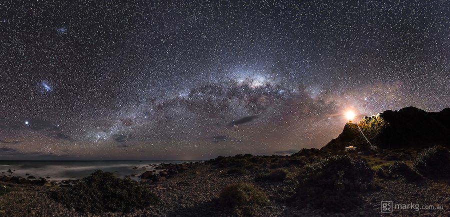 Winning image of the Astronomy Photographer of the Year 2013.<br /> <br /> I recently spent a night out at Cape Palliser on the North Island of New Zealand photographing the night sky. I awoke after a few hours sleep at 5am to see the Milky Way low in the sky above Cape Palliser. The only problem was my camera gear was at the top of the lighthouse as seen in the right of this image. I had set up a time-lapse there a few hours before, so I had to climb the 250 plus steps up there to retrieve my gear before I could take this photo. By the time I got back the sky was beginning to get lighter with sunrise 2 hours away. I took a 360 degree pano, with this being crop of around 180 degrees of that.