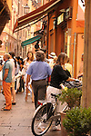 Busy market street in Bologna, Italy.