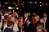 WEST PALM BEACH, FL ñ NOVEMBER 21: U.S. President Donald Trump his wife Melania Trump meet, greet and sign autograph for supporter on the tarmac  arrive together on Air Force One at the Palm Beach International Airport to spend Thanksgiving weekend at Mar-a-Largo resort November 21, 2017 in West Palm Beach, Florida. President Trump has made numerous trips to his Florida home since being President. Credit: MPI10 / MediaPunch NortePhoto.com