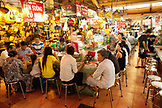VIETNAM, Saigon, Ben Thanh Market, people dine at one of the many small restaurants in the market, Ho Chi Minh City