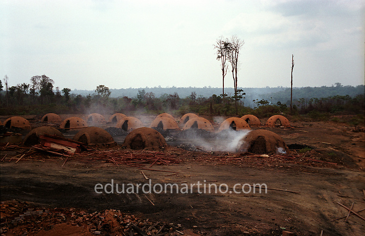 Modern-day Slavery in Brazil<br /> The furnaces of a charcoal producing farm on the edge of the Amazon rainforest. The Ministry of Labour's grupo movel (mobile unit), who work to end the use of unfree labour in the region, are developing a pioneering activity to assign responsibility for the slavery cases reported on such farms to the pig iron producing companies, as the charcoal is made to be sold exclusively to these extremely profitable companies.