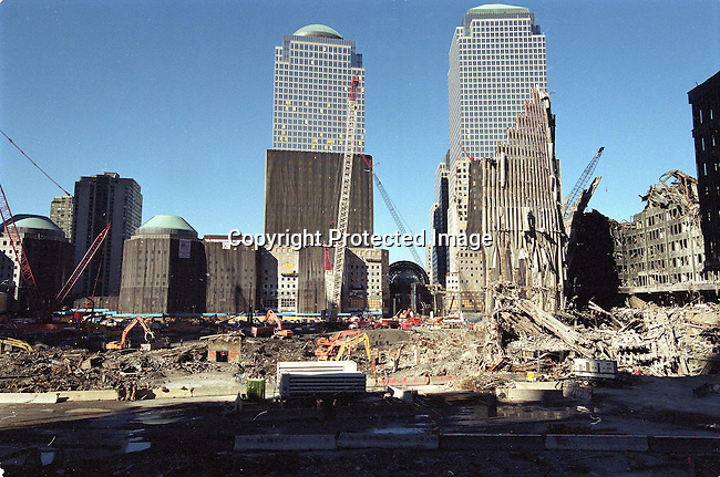 """Smoke rises from the earth as heavy machinery excavates debris from """"ground zero"""" November 9, 2001 in New York City. It is estimated that it will take a year to clear the debris from the site of the World Trade Center terror attacks.  .Photo: Per-Anders Pettersson/iAfrika Photos"""