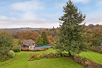 BNPS.co.uk (01202 558833)<br /> Pic: Fine&Country/BNPS<br /> <br /> Swimming pool in the garden<br /> <br /> Perfect corner of Ashdown forest...<br /> <br /> A beautiful country home in the heart of Ashdown Forest, the home of Winnie the Pooh, is on the market for £2.25m.<br /> <br /> End House is in a secluded spot of almost five acres in the East Sussex forest, with the nearest village about a mile away.<br /> <br /> The property has its own small stream for playing Pooh sticks and the new owner would have 'Commoner Rights' to use the 6,500-acre forest for grazing and wood cutting.<br /> <br /> Author AA Milne, who lived on the edge of Ashdown Forest, used the woodland there as the setting for his famous books about his son Christopher Robin's stuffed bear.
