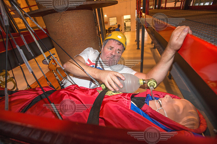 Crew from Norwegian Air Ambulance train urban rescue.<br /> Rescue paramedic J&oslash;rn Holmestrand with &quot;patient&quot;