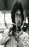 Robert Landau self portrait with Nikormat in fun house mirror 1971
