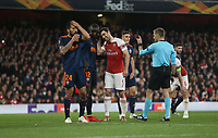 Arsenal's Sokratis Papastathopoulos and Mouctar Diakhaby of Valencia share a joke<br /> <br /> Photographer Rob Newell/CameraSport<br /> <br /> UEFA Europa League Semi-final 1st Leg - Arsenal v Valencia - Thursday 2nd May 2019 - The Emirates - London<br />  <br /> World Copyright © 2018 CameraSport. All rights reserved. 43 Linden Ave. Countesthorpe. Leicester. England. LE8 5PG - Tel: +44 (0) 116 277 4147 - admin@camerasport.com - www.camerasport.com