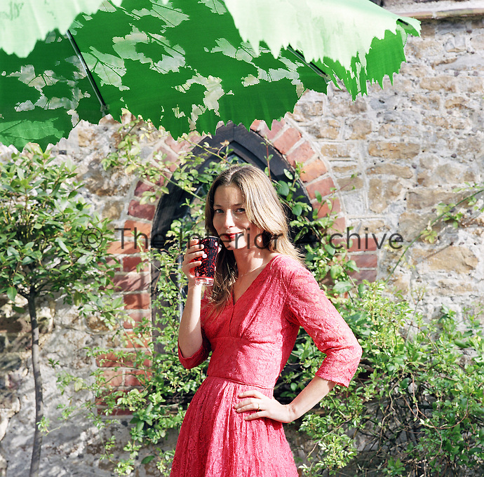 Lucie de la Falaise dressed in one of Pearl Lowe's lace dresses on the grounds of her estate in Hampshire