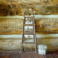 In the living room antique photographs are displayed in homespun frames imaginatively constructed from twigs and branches
