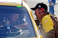 Feb. 27, 2009; Las Vegas, NV, USA; NASCAR Sprint Cup Series driver Kyle Busch (left) is congratulated by crew chief Steve Addington after qualifying for the Shelby 427 at Las Vegas Motor Speedway. Mandatory Credit: Mark J. Rebilas-