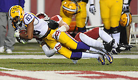 NWA Media/ANDY SHUPE - Arkansas' Brooks Ellis tackles Travin Dural (83) LSU's during the second quarter Saturday, Nov. 15, 2014, at Razorback Stadium in Fayetteville.