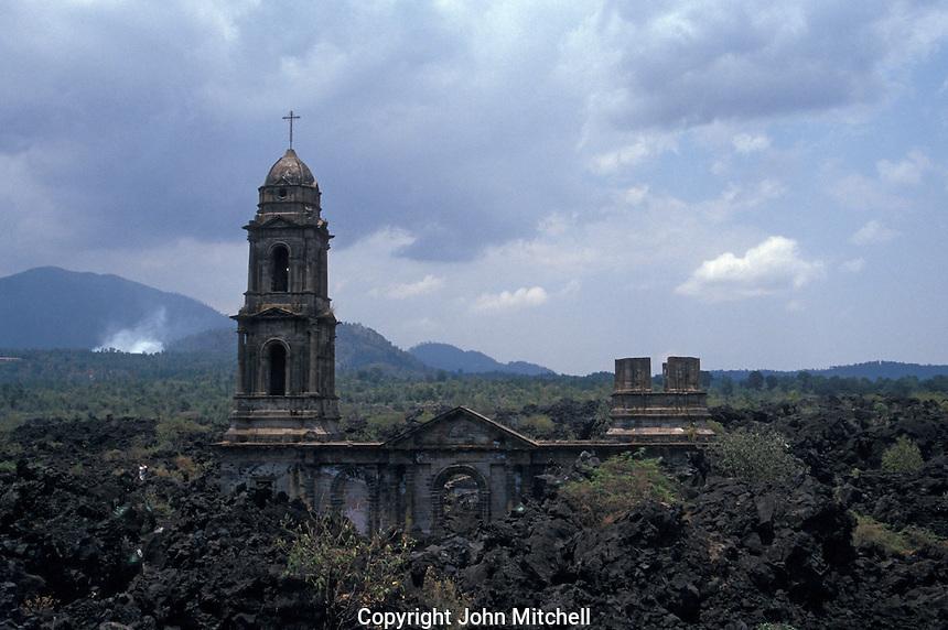 The ruined Templo de San Juan Parangaricutiro near Angahuan, Michoacan, Mexico. In 1943, this church was half-buried by a lava flow from nearby Volcan Paricutin.