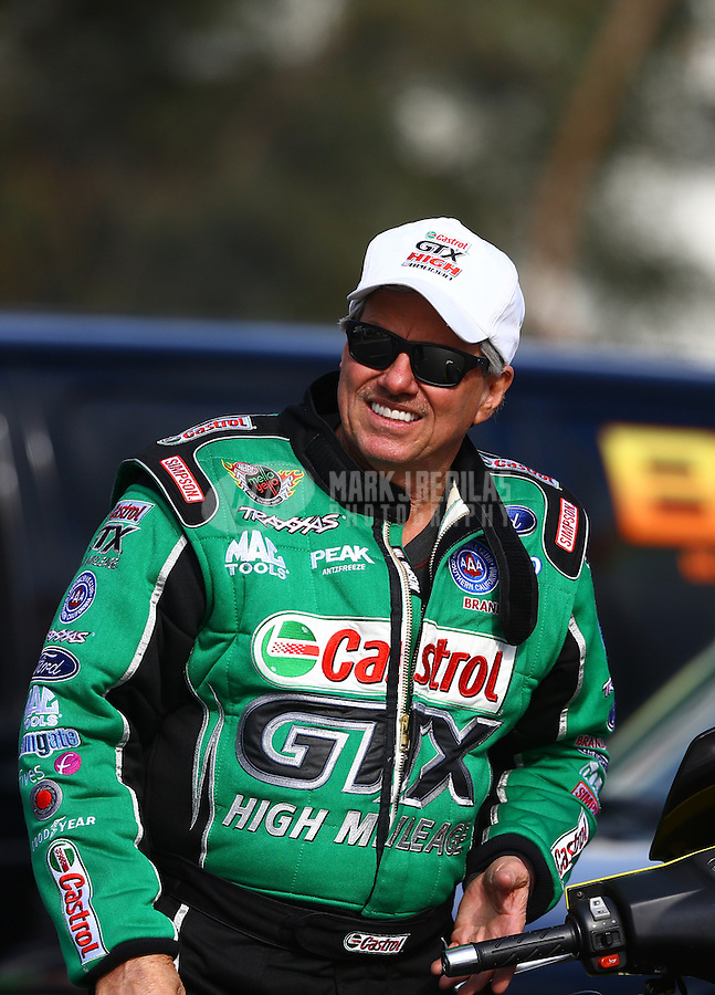 Feb 7, 2014; Pomona, CA, USA; NHRA funny car driver John Force during qualifying for the Winternationals at Auto Club Raceway at Pomona. Mandatory Credit: Mark J. Rebilas-