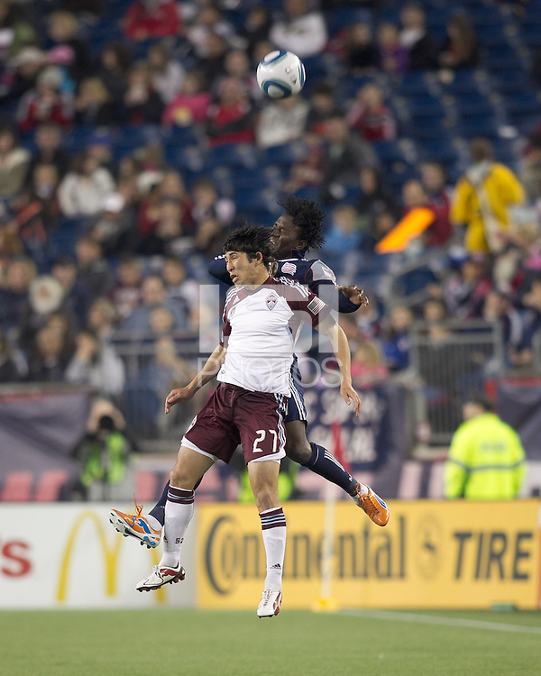 Colorado Rapids midfielder Kosuke Kimura (27) and New England Revolution forward Kenny Mansally (7) battle for head ball. In a Major League Soccer (MLS) match, the New England Revolution tied the Colorado Rapids, 0-0, at Gillette Stadium on May 7, 2011.