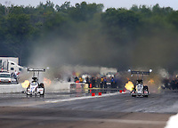 Aug 17, 2014; Brainerd, MN, USA; NHRA top fuel dragster driver Morgan Lucas (left) races alongside Bob Vandergriff Jr during the Lucas Oil Nationals at Brainerd International Raceway. Mandatory Credit: Mark J. Rebilas-