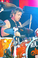Joey Kramer and Aerosmith perform at the Forum