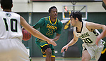 SPEARFISH, SD: NOVEMBER 11:  Makaleb Mcinnis #21 of Black Hills State looks to drive between Yellowstone Christian defenders Alfredo Pena #10 and Leonardo Lupiano #30 during their game Saturday at the Donald E. Young Center in Spearfish, S.D.   (Photo by Dick Carlson/Inertia)