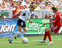 Megan Rapinoe tries to cut around a Canadian defender. The USA defeated Canada 2-0 at SAS Stadium in Cary, NC on Sunday, July 30, 2006.