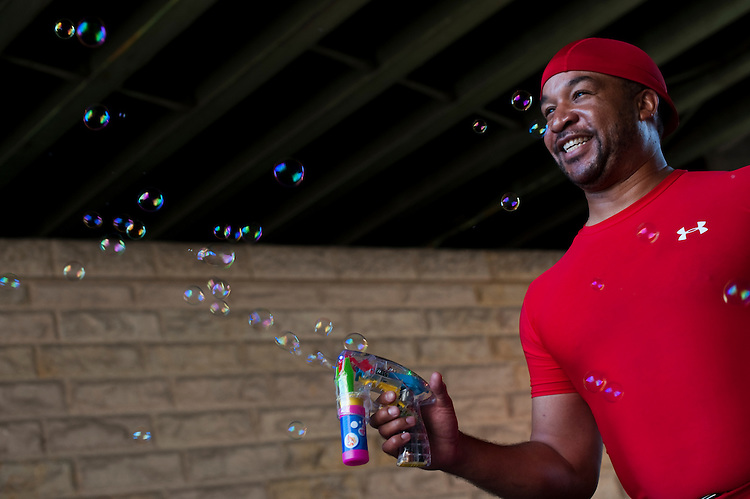 UNITED STATES - AUGUST 11: Jason Spillman shows off the bubble shooter he sells on 1st Street NE by Union Station on Thursday, Aug. 11, 2011. (Photo By Bill Clark/Roll Call)