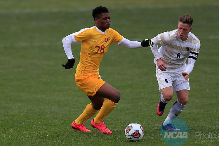KANSAS CITY, MO - DECEMBER 03:  Illal Osumanu (28) of the University of Charleston and Aksel Juul (6) of Wingate University battle for the ball during the Division II Men's Soccer Championship held at Children's Mercy Victory Field at Swope Soccer Village on December 03, 2016 in Kansas City, Missouri. Wingate beat Charleston 2-0 to win the National Championship. (Photo by Jack Dempsey/NCAA Photos via Getty Images)