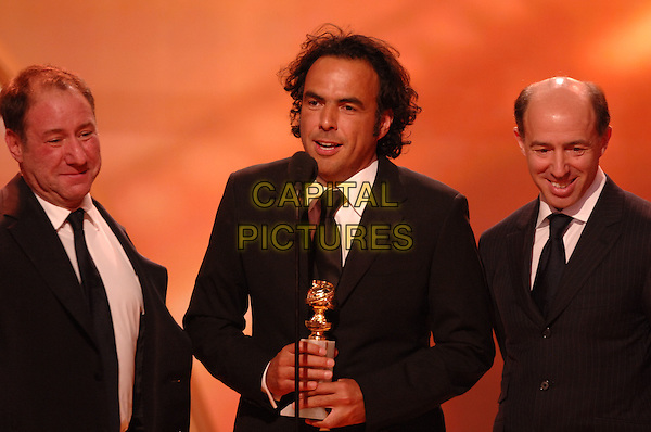 "ALEJANDRO GONZALEZ INARRITU .Accepts the award for Best Motion Picture - Drama for ""Babel"" .Telecast - 64th Annual Golden Globe Awards, Beverly Hills HIlton, Beverly Hills, California, USA..January 15th 2007. .globes half length microphone stage black suit jacket  trophy.CAP/AW.Please use accompanying story.Supplied by Capital Pictures.© HFPA"" and ""64th Golden Globe Awards"""