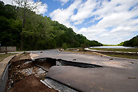NWA Democrat-Gazette/JASON IVESTER<br /> A washed out portion of the road at Lake Atalanta is seen on Monday, May 1, 2017, in Rogers. The park is closed until further notice.