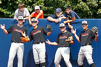 Pitcher Hayden Hurst #28, pitcher Nick Travieso #23, catcher Stryker Trahan #22, and third baseman Nick Basto #12 joke around for the camera with four fans who climbed over the outfield fence during practice for the Under Armour All-American Game presented by Baseball Factory at Les Miller Field on August 12, 2011 in Chicago, Illinois.  (Mike Janes/Four Seam Images)