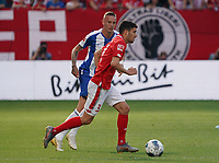 Aaron Martin (1. FSV Mainz 05) gegen Marius Wolf (Hertha BSC Berlin) - 14.09.2019: 1. FSV Mainz 05 vs. Hertha BSC Berlin, 4. Spieltag Bundesliga, OPEL Arena<br /> DISCLAIMER: DFL regulations prohibit any use of photographs as image sequences and/or quasi-video.