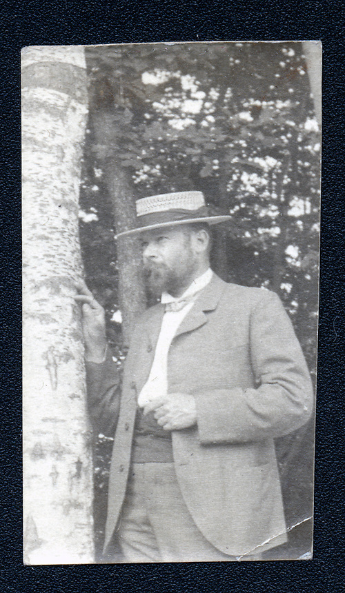 27a.<br /> <br /> 2 1/16  x  1 3/16  [b+w]<br /> <br /> S. H. Crone, frontal figure three-quarter length, wearing open suit coat and straw hat, with right hand on birch tree in grove.
