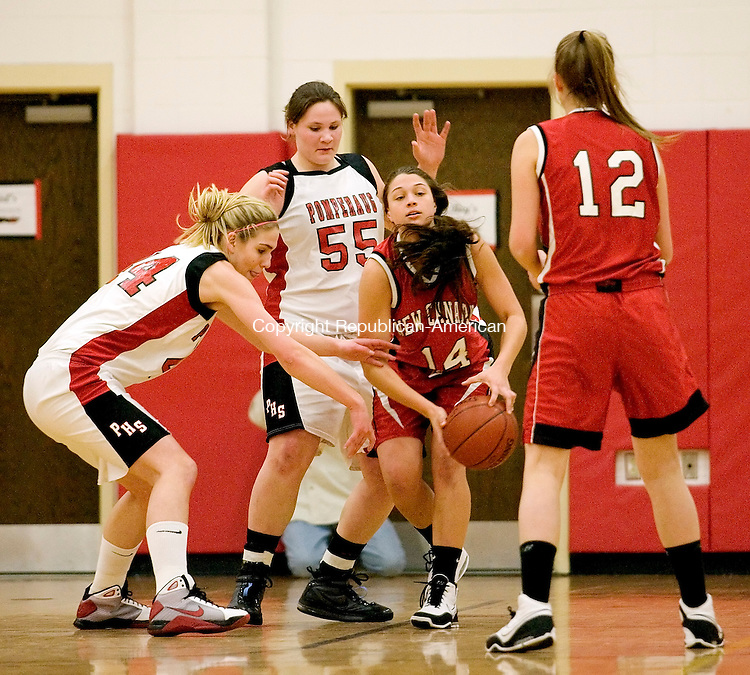 Southbury, CT-04, March 2010-030410CM03  Pomperaug's Katlin Cizynski (#44) and Mary Haase (55) go after the ball held by New Canaan's Erin Fessler Thursday night in Southbury.  With her is teammate Christina Loop (#12).  Pomperaug defeated New Canaan 67-51. --Christopher Massa Republican-American