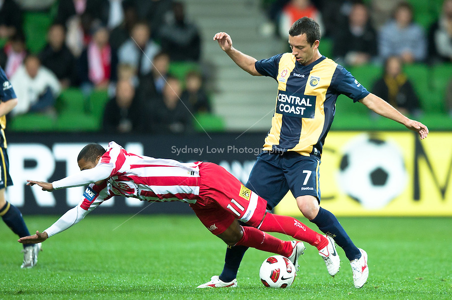 MELBOURNE, AUSTRALIA - AUGUST 5, 2010: Oliver Bozanic from the Heart is fouled by John Hutchinson from the Mariners in Round 1 of the 2010 A-League between the Melbourne Heart and Central Coast Mariners at AAMI Park on August 5, 2010 in Melbourne, Australia. (Photo by Sydney Low / www.syd-low.com)