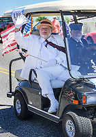 A man dressed as Dr. Emlen Physick waves to the crowd during the Independence Parade Saturday July 2, 2016 on Beach Avenue in Cape May, New Jersey. Photo by William Thomas Cain/Cain Images