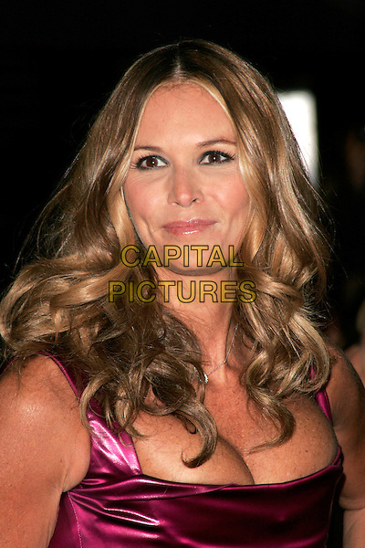 """ELLE MacPHERSON .The Royal World Premiere of """"Quantum Of Solace"""" at the Odeon Leicester Square, London, England..October 29th 2008.James Bond headshot portrait cleavage pink fuschia .CAP/AH.©Adam Houghton/Capital Pictures."""