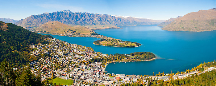 An Aerial Photo of Queenstown and Lake Wakatipu, South Island, New Zealand. From the centre of Queenstown, you can take a gondola ride into the mountains. On reaching the top you are faced by extremely impressive views over the entirity of Queenstown and Lake Wakatipu. The two sections of land jutting out into the centre of Lake Wakatipu are host to one of the most perfectly placed golf courses in the world (the furthest section), and the beautiful Botanical Gardens (closest section).
