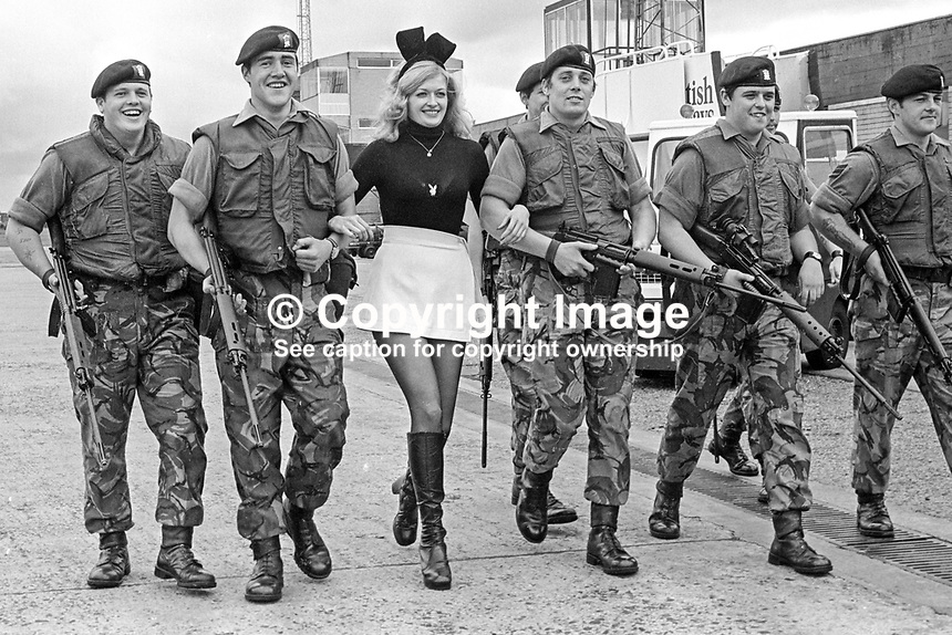 Bunny girl Theresa Lewis, 22 years, from the London Playboy Club, is welcomed by soldiers from the Royal Regiment of Wales currently serving in N Ireland. Theresa is the regimental pin-up and she paid a flying visit to them on 5th July 1974. 197407050379b..Copyright Image from Victor Patterson, 54 Dorchester Park, Belfast, United Kingdom, UK...For my Terms and Conditions of Use go to http://www.victorpatterson.com/Victor_Patterson/Terms_%26_Conditions.html