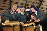 ***NO FEE PIC***.28/01/2011.Members of Sabor Cubano Danny Lopez with schoolchildren fro Our LAdy's Terenure.Sadhbh Walsh, Grainne McMahon, Kate Jester.at the Caribean part of the Holiday World Show in the RDS which runs from Friday 28th Jan - Sunday 30th Jan, Dublin..Photo: Gareth Chaney Collins