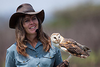Shannon Hoffman showing a barn owl  during her flight display show. The shows are aimed at educating children and adults and have a strong conservation message..October 2010..African Bird of Prey Sanctuary..Kwazulu-Natal, South Africa.