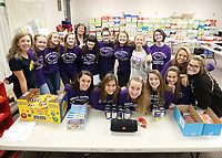 Guerin students helped fill food boxes at St. Maria Goretti for distribution at Thanksgiving.
